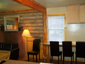 4 Bedroom lakeside - Group size 3 bath cabin with kitchen, 4 fireplaces and bar. #13 Picture 10