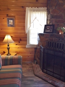 1 & 2 Bedroom cottages - Medium size 2 story. Pet friendly. Kitchen and fireplace. #7,19,24 Picture 15