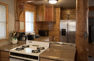 4 Bedroom lakeside - Group size 3 bath cabin with kitchen, 4 fireplaces and bar. Pet friendly #13 Photo 5