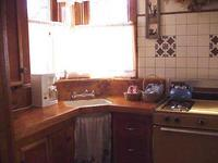 2 Bedroom spa cottages (with Jacuzzi or Hot Tub) - Kitchen and fireplace. #10,16 Picture 9