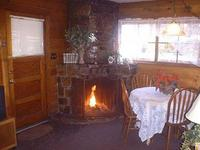 2 Bedroom spa cottages (with Jacuzzi or Hot Tub) - Kitchen and fireplace. #10,16 Picture 11